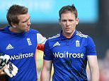 England's Eoin Morgan (right) leaves the pitch after being hit on the helmet by a delivery from Mitchell Starc, during the fifth match of the Royal London One Day International Series at Emirates Old Trafford, Manchester.   PRESS ASSOCIATION Photo. Picture date: Sunday September 13, 2015. See PA story CRICKET England. Photo credit should read: Martin Rickett/PA Wire.   RESTRICTIONS: Editorial use only. No commercial use without prior written consent of the ECB. Still image use only no moving images to emulate broadcast. No removing or obscuring of sponsor logos. Call +44 (0)1158 447447 for further information.