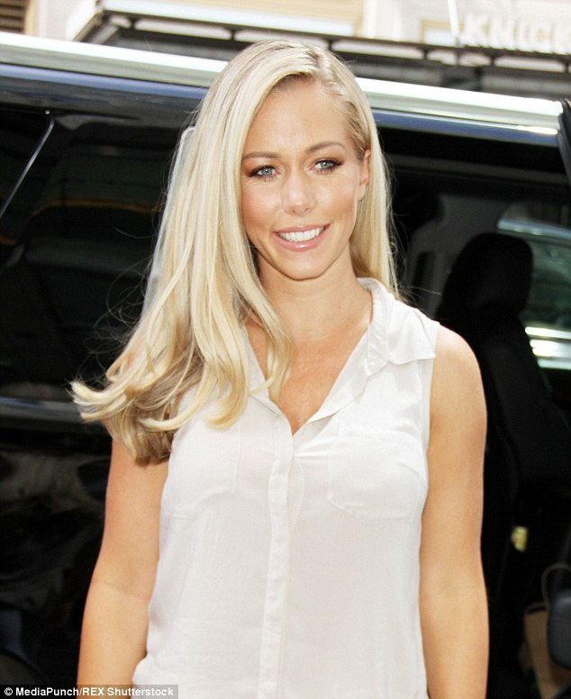 Modern mom: Kendra Wilkinson chopped her quintessential long locks and went for a lighter shade of blonde for a more sophisticated and chic look