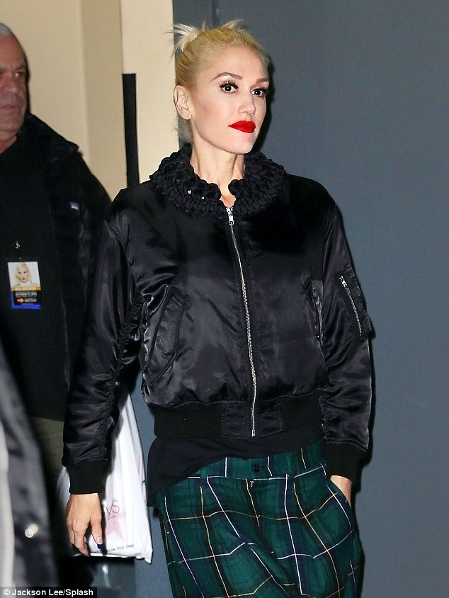Totes on trend: Gwen, 46, rocked a pair of green tartan culottes which she paired with another autumnal must-have - a bomber jacket - as she strutted out of the Hammerstein Ballroom