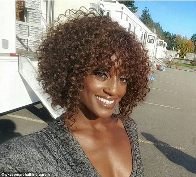 Actress Skye P. Marshall - who plays Toni's sister Towanda Braxton - smiled as she stood by production trailers on Wednesday