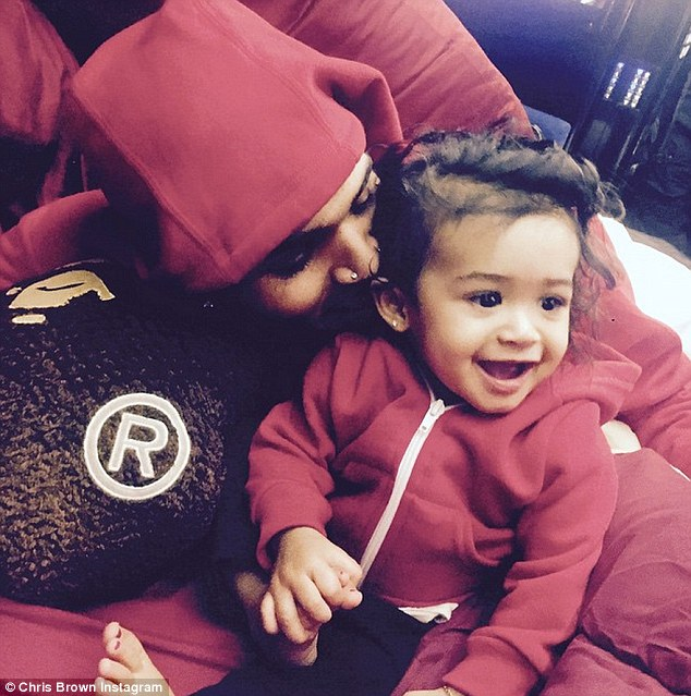 Chris' mini me: 'God has blessed me with my twin. #ROYALTY,' Chris gushed as he mentioned his daughter for the first time on social media in April