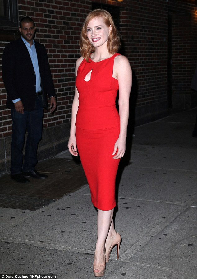 Hamming it up: The beautiful redhead posed for pictures outside the legendary Ed Sullivan Theatre as she wore a pair of beige Christian Louboutin heels