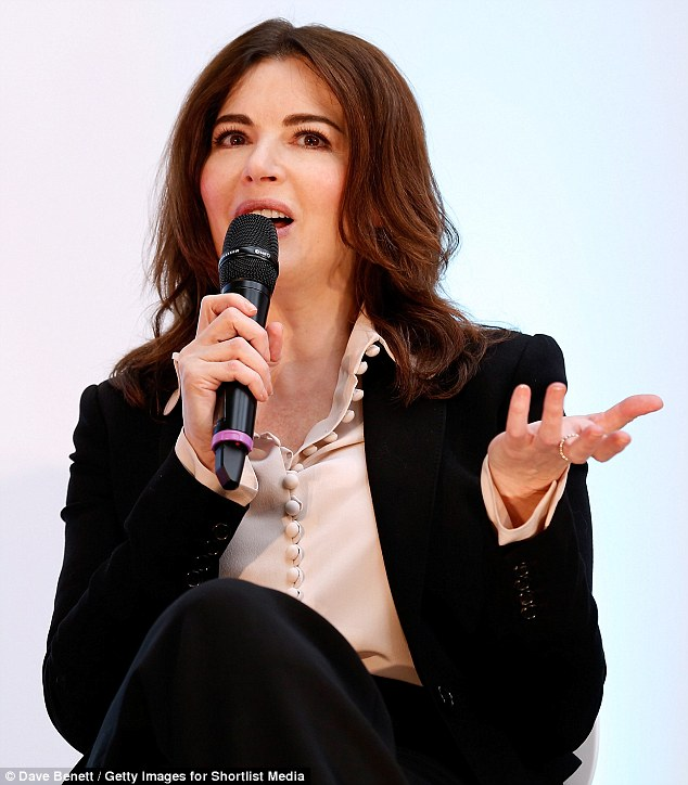 A woman's touch: Nigella, 55, picked out a feminine blouse which she wore partly unbuttoned for her appearance at Stylist Live which was held at the capital's Business Design Centre