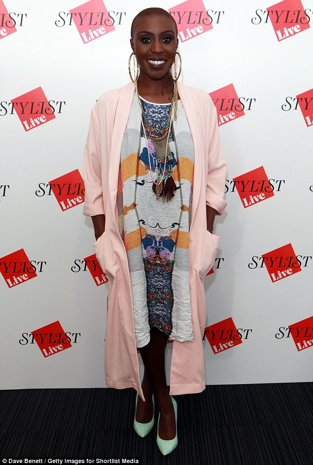 Showing her face: Singer Laura Mvula showcased her experimental dress sense in a colour-clashing outfit as she turned up on Saturday to explore the festival