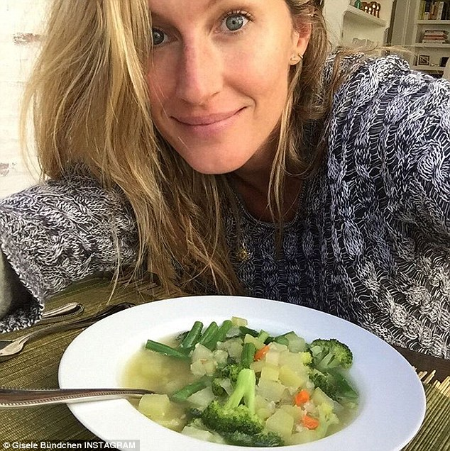 She eats right: Makeup-free Gisele Bundchen showed off a bowl of vegetables she made herself using 'mom's recipe' in a Friday Instagram post. The beauty captioned the snap, 'Leftovers from yesterday turned into a veggie soup'
