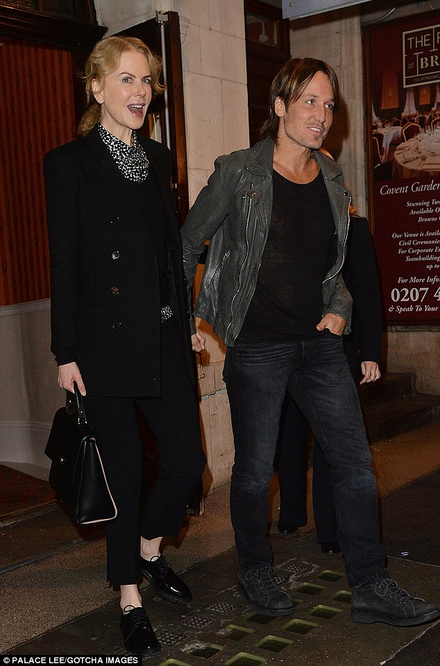 Stepping out: Nicole had the look of love as she headed out into the night with her beau Keith Urban
