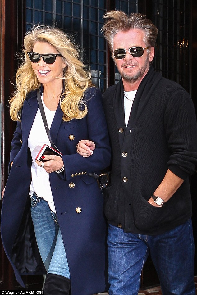 Happy couple:Christie Brinkley and her rocker boyfriend John Mellencamp looked a picture of bliss out in New York on Friday