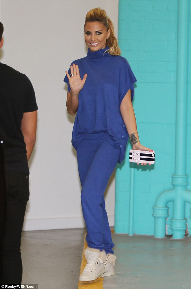 Blue babe:The 37-year-old changed into a low-key cobalt, blue two-piece tracksuit with high-top white trainers after she'd appeared on the show in a more typically glamorous ensemble