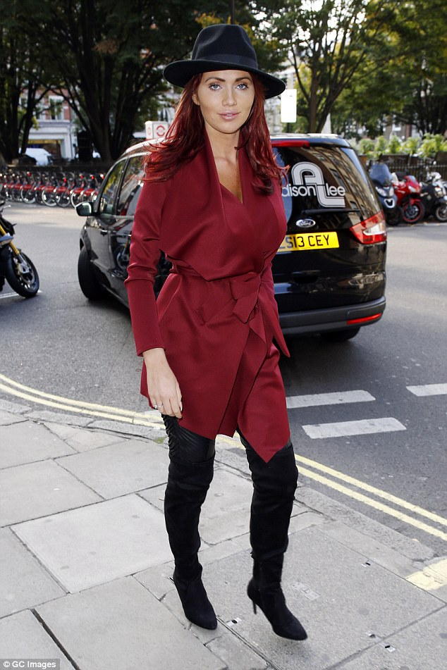 Troubling time: Amy, pictured out and about on Tuesday, has reportedly ended things with Bradley, with his reported jail term days after she spoke out on her boyfriend sexting another woman