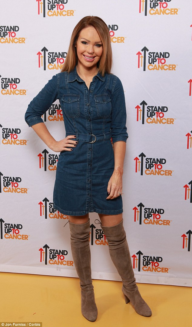 Gorgeous: Katie Piper teamed her denim shirt dress with some suede thigh-high boots