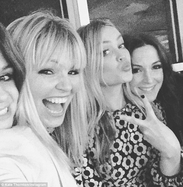 Old friends: Kate Thornton cosied up to TV personality Laura Whitmore on the night