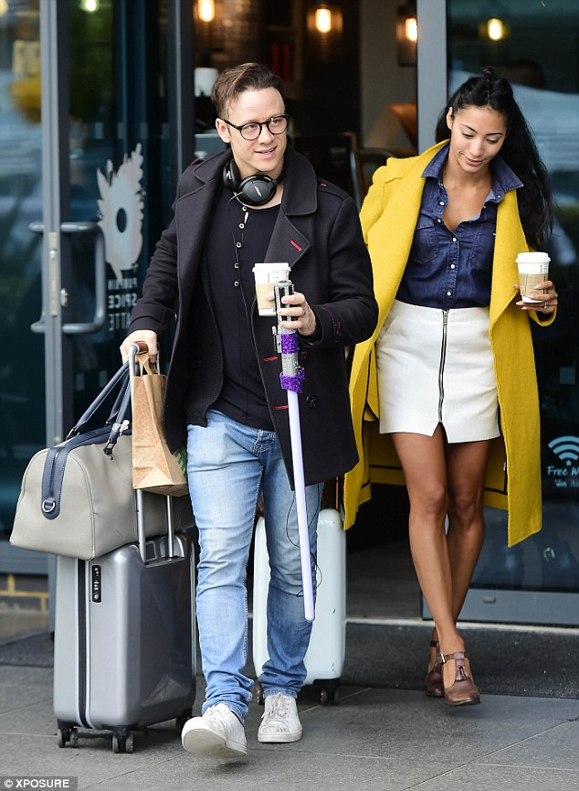 Colourful look:Strictly's very own married couple, Kevin Clifton and his stunning wife Karen left together with Karen going for a bright yellow coat with a denim shirt and white skirt.
