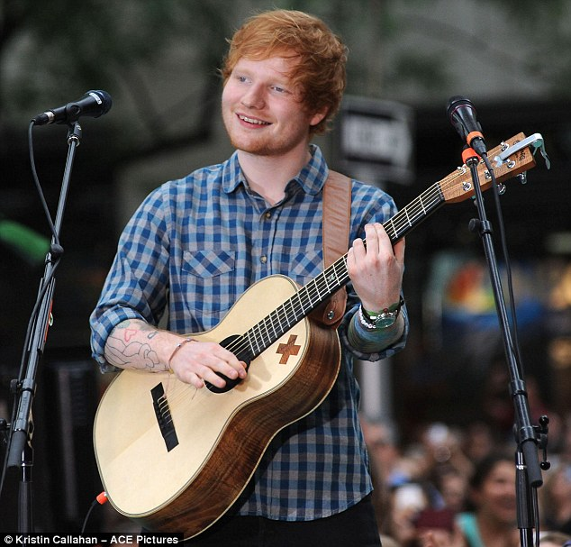 Sharp-eared: As the host whispered into Mark's ear, Twitter users speculated Ed Sheeran or Electric Light Orchestra (ELO) have bagged the top spot