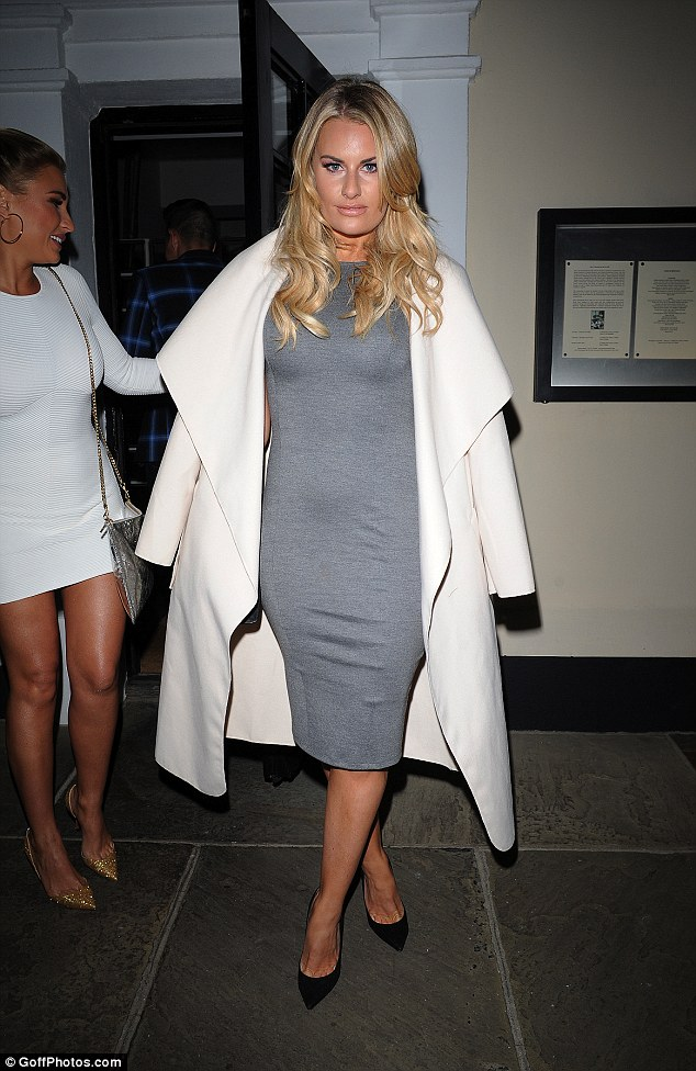Blonde beauty:The Essex contingent were out in force as Danielle Armstrong also joined the party looking demure in a grey midi-dress with a white waterfall coat over the top