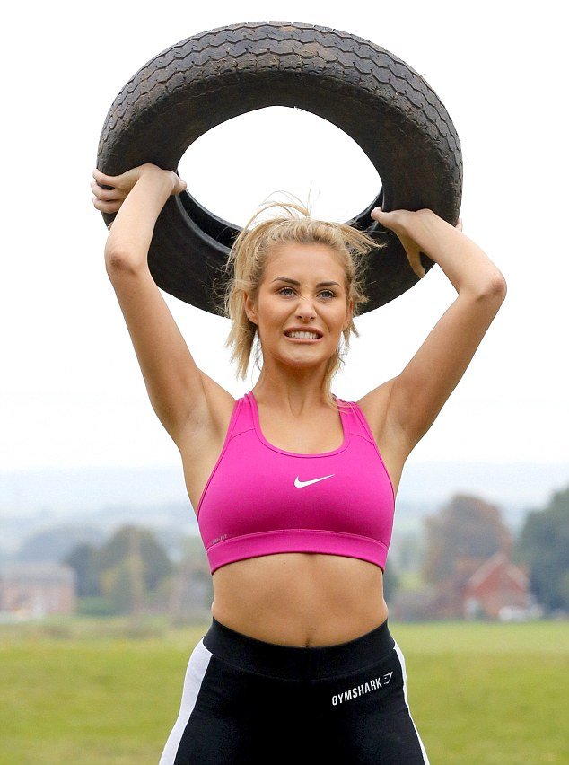 Smile through the pain: Chloe put all her energy and strength into the intense workout which involved lifting tyres above her head