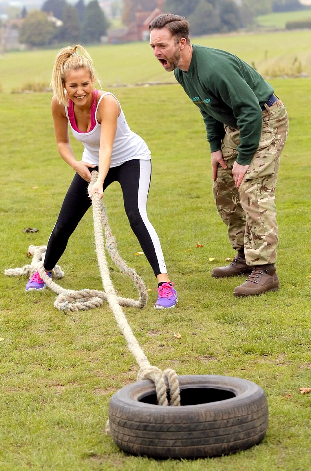 No pain, no gain: Chloe was given words of encouragement by the military trainer who screamed in her ear as she pulled a tyre along the ground with a heavy rope