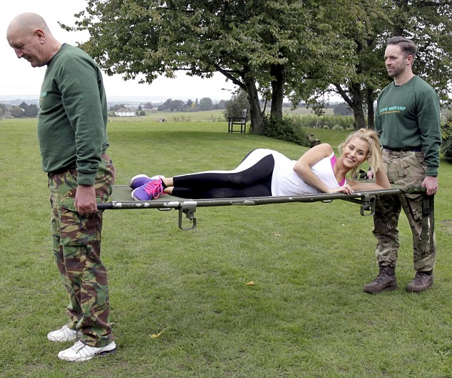 And relax: Chloe gave the trainers a taste of their own medicine and had them carry her on a stretcher after working out