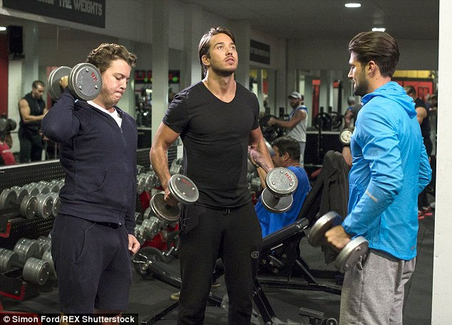 Not quite so relaxed... But while Arg was getting his pamper, it was a different story for some of his other male co-stars who were instead seen pumping some iron in a gym across town
