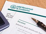Closeup of UK tax return form with HM Revenue & Customs logo. CMWR8J