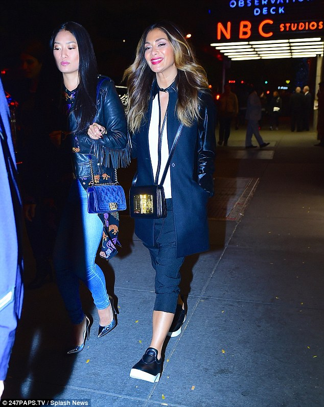 Girls night: Nicole Scherzinger enjoyed an evening out in New York on Friday, watching the Live Orchestra rendition of Back to the Future at Radio City Music Hall
