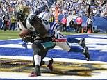 Hurns makes an eight-yard touchdown reception against the Colts' Darius Butler in Indianapolis