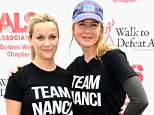 """LOS ANGELES, CA - OCTOBER 18:  (L-R) Actors  Reese Witherspoon and  RenÈe Zellweger attend the Nanci Ryder's """"Team Nanci"""" At The 13th Annual LA County Walk To Defeat ALS at Exposition Park on October 18, 2015 in Los Angeles, California.  (Photo by Frazer Harrison/Getty Images)"""