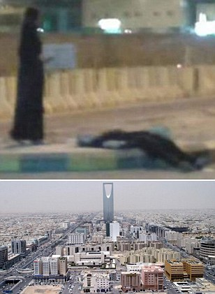 DRUNK Saudi Arabian woman lies passed out in the street in photo