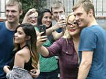 Hollywood, CA -  Nick Carter is all smiles as he takes a large amount of selfies with his fans as he arrives at the DWTS studio.  His partner, Sharna Burgess, looks quite amused as she heads in. \nAKM-GSI         October 16, 2015\nTo License These Photos, Please Contact :\nSteve Ginsburg\n(310) 505-8447\n(323) 423-9397\nsteve@akmgsi.com\nsales@akmgsi.com\nor\nMaria Buda\n(917) 242-1505\nmbuda@akmgsi.com\nginsburgspalyinc@gmail.com