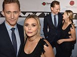 "NASHVILLE, TN - OCTOBER 17:  Actor Tom Hiddleston, left, and actress Elizabeth Olsen attend the premiere of ""I Saw The Light"" at The Belcourt Theatre on October 17, 2015 in Nashville, Tennessee.  (Photo by John Shearer/Getty Images)"
