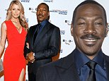 Eddie Murphy, his partner Paige Butcher, and mother Lillian Murphy arrive for the Mark Twain prize for Humor honoring Murphy at the Kennedy Center in Washington October 18, 2015.      REUTERS/Joshua Roberts