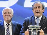 FILE - In this Friday, Sept. 19, 2014 file photo, UEFA President Michel Platini, right, shows The Henri Delaunay trophy of the UEFA European Football Championship next to, Britain's Greg Dyke, chairman of The Football Association (FA). Michel Platini lost England's support for his FIFA presidential bid on Friday Oct. 16, 2015, signaling the first crack in the European unity behind the Frenchman that UEFA had sought to portray. (Laurent Gillieron/Keystone via AP, File) SWITZERLAND OUT