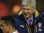 WATFORD, ENGLAND - OCTOBER 17:  Alexis Sanchez of Arsenal shakes hands with Arsene Wenger the Arsenal Manager as he is subbed during the Barclays Premier League match between Watford and Arsenal at Vicarage Road on October 17, 2015 in Watford, England.  (Photo by David Price/Arsenal FC via Getty Images)