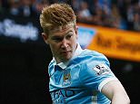 MANCHESTER, ENGLAND - OCTOBER 17: Kevin de Bruyne of Manchester City and Simon Francis of Bournemouth compete for the ball during the Barclays Premier League match between Manchester City and A.F.C. Bournemouth at Etihad Stadium on October 17, 2015 in Manchester, England.  (Photo by Dean Mouhtaropoulos/Getty Images)