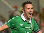 Ireland's forward Robbie Keane celebrates after scoring a goal during the Euro 2016 qualifying football match Gibraltar vs Republic of Ireland at the Algarve stadium in Faro on September 4, 2015.   AFP PHOTO/ FRANCISCO LEONG        (Photo credit should read FRANCISCO LEONG/AFP/Getty Images)