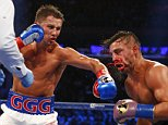 Gennady Golovkin, left, hits David Lemieux in the eighth round of a world middleweight title fight at Madison Square Garden in New York on Saturday, Oct. 17, 2015. Golovkin won by a TKO in the eighth round. (AP Photo/Rich Schultz)