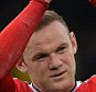 epa04981266 Manchester United's Wayne Rooney waves to the crowd at the end of the English Premier League soccer match between Everton and Manchester United at Goodison Park, Liverpool, Britain, 17 October 2015. Manchester won the match 3-0.  EPA/PETER POWELL EDITORIAL USE ONLY. No use with unauthorized audio, video, data, fixture lists, club/league logos or 'live' services. Online in-match use limited to 75 images, no video emulation. No use in betting, games or single club/league/player publications