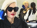 Gwen Stefani arrives at JFK airport in NYC.\n\nPictured: Gwen Stefani\nRef: SPL1154221  181015  \nPicture by: Splash News\n\nSplash News and Pictures\nLos Angeles: 310-821-2666\nNew York: 212-619-2666\nLondon: 870-934-2666\nphotodesk@splashnews.com\n