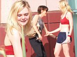 Picture Shows: Elle Fanning  October 17, 2015\n \n Actress, Elle Fanning and her trainer are seen leaving the gym after a workout in Studio City, California. Elle gave her trainer a gift of headphone and a long hug before taking off.\n \n EXCLUSIVE all round\n UK RIGHTS ONLY\n \n Pictures by : FameFlynet UK � 2015\n Tel : +44 (0)20 3551 5049\n Email : info@fameflynet.uk.com