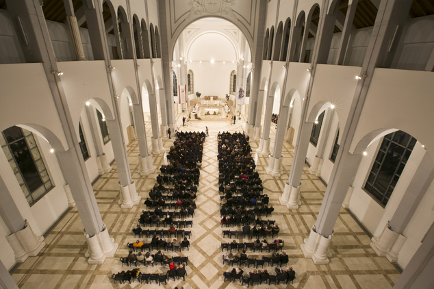 Worshipers pray during the Easter Vigil mass at Mother Teresa Cathedral in Kosovo capital Pristina Saturday, April 4, 2015 as Catholics prepare for Easter Su...