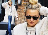 Kate Hudson in Tribecca in denim flare jeans, cream colored top, blue beads across her neck and hair tied up in a bun holding a coffee cup on one hand on Sunday October 18th, 2015. Non-Exclusive / Luis Yllanes / Splash News\n\nPictured: Kate Hudson\nRef: SPL1153804  181015  \nPicture by: Luis Yllanes / Splash News\n\nSplash News and Pictures\nLos Angeles: 310-821-2666\nNew York: 212-619-2666\nLondon: 870-934-2666\nphotodesk@splashnews.com\n