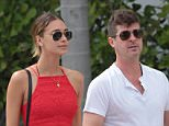 143825,  Robin Thicke and his girlfriend April Love Geary spend time poolside with his son Julian in Miami. A shirtless Robin showed off his 'dad bod' as he ate french fries and drank cocktail while spending the afternoon with his beautiful girlfriend April and his son Julian. April appeared at one point in a tight red dress, catching a glance from their pool boy. Miami, Florida - Saturday October 17, 2015. Photograph: Brett Kaffee/Thibault Monnier, © Pacific Coast News. Los Angeles Office: +1 310.822.0419 sales@pacificcoastnews.com FEE MUST BE AGREED PRIOR TO USAGE