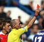 Referee Mike Dean pulls a red card for Gabriel Paulista of Arsenal   during the Barclays Premier League match Chelsea and Arsenal  played at Stamford Bridge, London