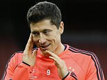 Bayern's Robert Lewandowski holds his head during a soccer training session at Emirates stadium in London Monday, Oct. 19, 2015. Arsenal will play Bayern Munich in a Champions League Group F soccer match at the stadium on Tuesday. (AP Photo/Kirsty Wigglesworth)