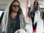 EXCLUSIVE:  Russell Brand is seen arriving at Perth Domestic Airport in Perth, Western Australia\n\nPictured: Russell Brand\nRef: SPL1154653  191015   EXCLUSIVE\nPicture by: Splash News\n\nSplash News and Pictures\nLos Angeles: 310-821-2666\nNew York: 212-619-2666\nLondon: 870-934-2666\nphotodesk@splashnews.com\n
