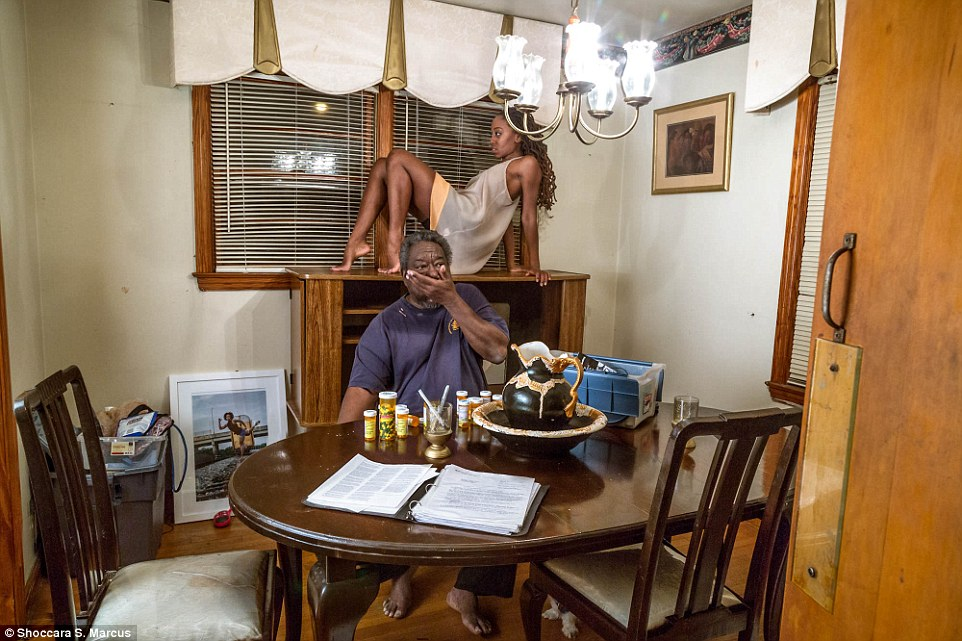 Marcus said the experience forced her to revisit her past and also reevaluate her role in her family (Marcus above as her father takes medication)