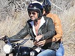 Please contact X17 before any use of these exclusive photos - x17@x17agency.com   Gerard Butler and his girlfriend Morgan take a ride up the oast and help out his friend that is also riding a motorcycle before getting back on the road, October 19,  2015 X17online.com EXCLUSIVE  /X17online.com