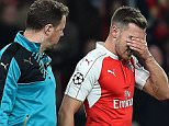 Arsenal's Welsh midfielder Aaron Ramsey (R) leaves the pitch injured during the UEFA Champions League football match between Arsenal and Bayern Munich at the Emirates Stadium in London, on October 20, 2015. Arsenal won the match 2-0.   AFP PHOTO / BEN STANSALLBEN STANSALL/AFP/Getty Images