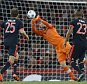 Bayern's Arturo Vidal, right, kicks the ball  torwards Arsenal goalkeeper Petr Cech during the Champions League Group F soccer match between Arsenal and Bayern Munich at Emirates stadium in London Tuesday, Oct. 20, 2015. (AP Photo/Kirsty Wigglesworth)