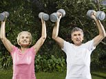 Couple Lifting Weights --- Image by © Betsie van der Meer/Corbis couples, men, physical fitness, weightlifting, women