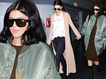 Kylie Jenner and Kendall Jenner were spotted having some sisterly bonding time as they landed at JFK Airport in NYC. The model sisters held each others hands as they walked off a flight from LA. They didn't hide their faces from the photographers, and chose to embrace the moment. Kylie wore an Olive green dress, with a matching Oversized bomber jacket as they touched down for a Balmain x H&M event tomorrow.\n\nPictured: Kylie Jenner, Kendall Jenner\nRef: SPL1155772  191015  \nPicture by: 247PAPS.TV / Splash News\n\nSplash News and Pictures\nLos Angeles: 310-821-2666\nNew York: 212-619-2666\nLondon: 870-934-2666\nphotodesk@splashnews.com\n